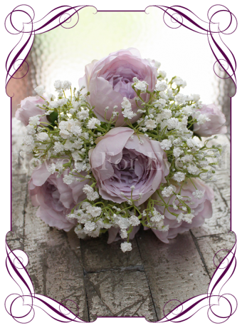 A classic silk bridal bouquet style with sort after romantic artificial blooms. Very affordable for brides looking for a simple look with peonies and baby's breath.