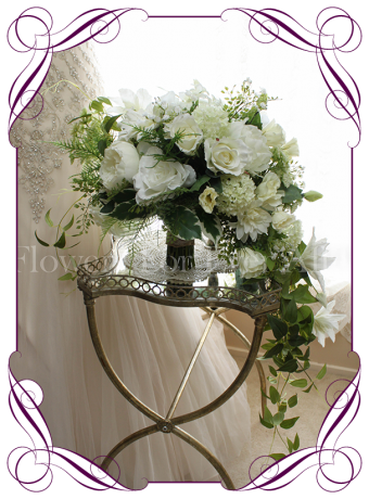 Large cascading silk artificial bridal bouquet in a large variety of white blooms and textures for a very unique vintage design. Unique wedding flowers with a real look