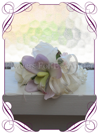 Ladies wrist corsage with silk artificial ivory white roses and lilac mauve orchid set onto pearl bracelet