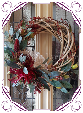 Artificial Australian Native Floral Wreath featuring artificial eucalyptus, protea, leucadendron and berries. Perfect for Christmas, Home Decor or Wedding Floral Decor, the perfect rustic floral look. Made in Melbourne.