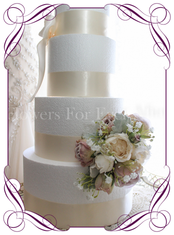 Rustic wedding cake decoration in silk artificial flowers, with mauve roses and ivory peonies with baby's breath. Made in Melbourne. Shipping world wide.
