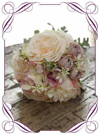 Blush toned artificial roses and hydrangea in a bridesmaid posy bouquet to match Bridal bouquet and create your own package check our store for more pieces. Made in Melbourne, Custom Orders Available.