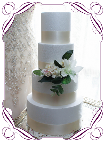 white and blush silk flower wedding cake decoration.