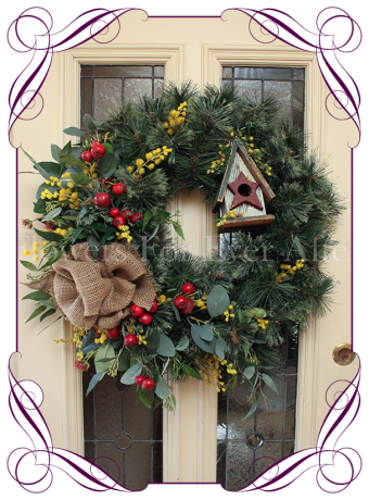 Christmas door wreath with Australian native gum and gumnuts. Burlap, wattle, wooden bird house and Australian native gum flowers and red crabapples.