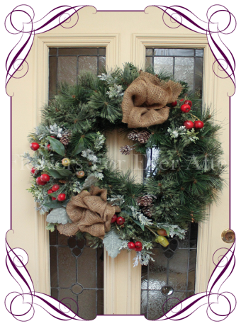 Christmas door wreath with Australian native gum and gumnuts. Burlap and pine cones, plus red crabapples