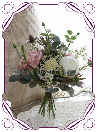 High quality realistic silk artificial bridesmaid posy wedding bouquet with pastel tones of dusty pink roses, ivory roses, thistle, leucondendron and other Australian Native flowers and gum leaves. Made in Melbourne Australia, shipped world wide. Buy online.