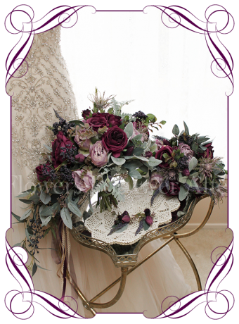 Silk artificial deep tone vintage style cascading posy for purple lilac or navy wedding themes, with roses, peonies, navy berries, native gum leaves. Package set with bride, bridesmaids and buttons.
