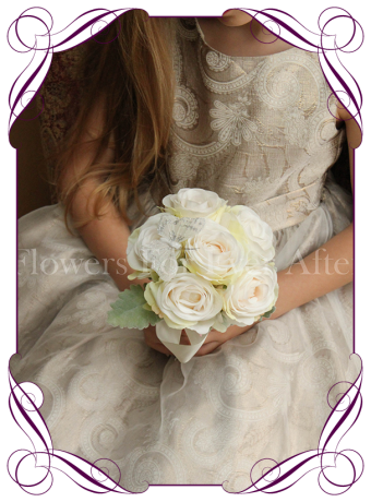 Silk artificial tinted ivory wedding flower girls posy bouquet with roses and butterfly.