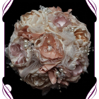 Vintage glamour, temperance bridesmaid bouquet, this design is made entirely with fabric and handmade flowers. With laces, crystals and pearls throughout, the brooch bouquet, bling bouquet, vintage brooch