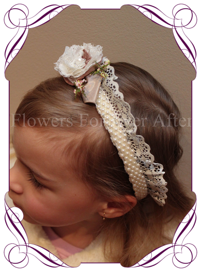 Stunning vintage look headband. Features a handmade lace and fabric flower set onto a band of champagne beads and lace trim. This is a childs size. Not suitable for babies…for babies we can custom make a headband set onto an elastic lace. Suited to match the Evangeline, Gabriella, Temperance or Tahani bouquet designs