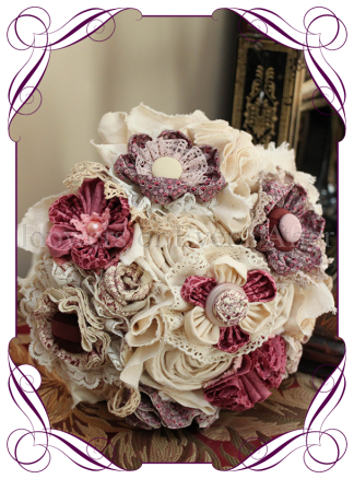 Vintage glamour, temperance bridesmaid bouquet, this design is made entirely with fabric and handmade flowers. With laces, crystals and pearls throughout, the brooch bouquet, bling bouquet, country style rustic bridal bouquet in fabric flowers. Dusty pink and cream with buttons and lace