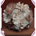 Vintage glamour elegant bridal design. Features all hand made fabric flowers, each set with brooches. Fabrics used are in ivories, creams, champagnes, dusty pinks, apricots and golds, with scattered gold wired diamante crystals, gold metal loops and laces. brooch bouquet, bling bouquet