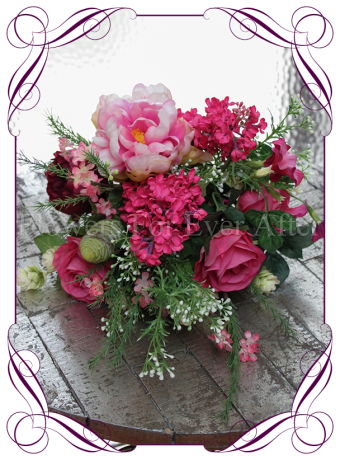 A beautiful loose garden picked artificial bridal bouquet in a variety of bright pinks, including fuchsia pink, hot pink and magenta pink. Perfect for a garden or rustic wedding.