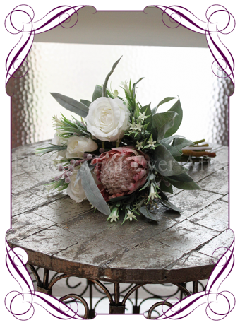 Dusty pink artificial protea and ivory white silk rose bridesmaid posy . A perfect artificial rustic wedding bouquet