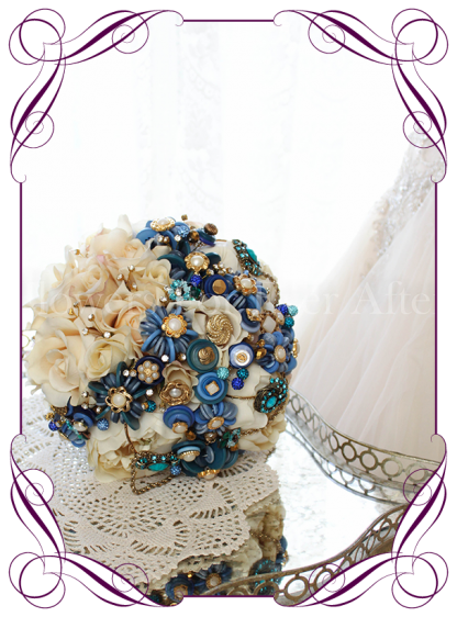 Blue button bouquet featuring a variation of button flowers exclusively designed in our studio this design also features button stacks in gold/pearl and blue aswell as gold cased diamantes and blue crystals on a vanilla silk rose and peony base. S