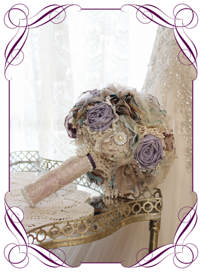 Fabric flower bouquet. All handmade fabric flowers with crotchet lace, lace and brooch details. A very vintage style in warn lavender and merlot wine tones.
