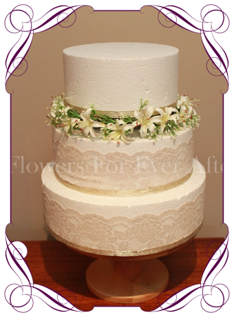 Cake flowers / cake halo. A full ring of artificial white flowers perfect for a wedding cake