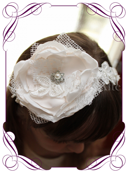 A sweet girls flower and lace headband perfect for communions, confirmation and flower girls hair styles.