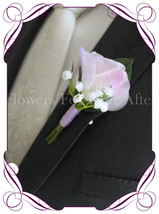 Silk artificial gents wedding flower button with a lilac purple rose and baby's breath.