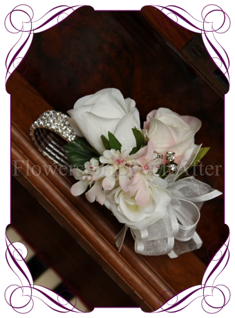 Bling bracelet wrist corsage with silk artificial blush and white flowers.