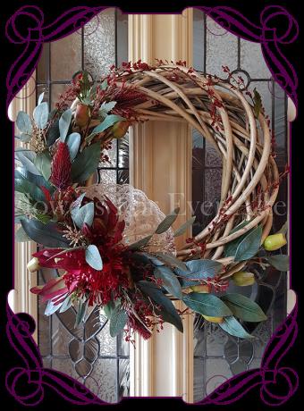 Artificial Australian Native Floral Wreath featuring artificial eucalyptus, protea, leucadendron and berries. Perfect for Christmas, Home Decor or Wedding Floral Decor, the perfect rustic floral look. Made in Melbourne.