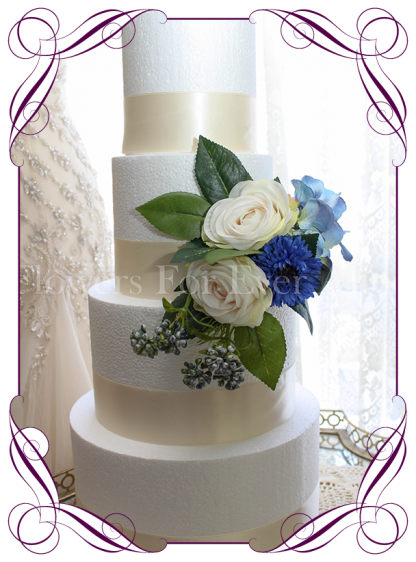 Rustic wedding cake decoration in silk artificial flowers, with blue cornflower, hydrangea and ivory roses with berries. Made in Melbourne. Shipping world wide.