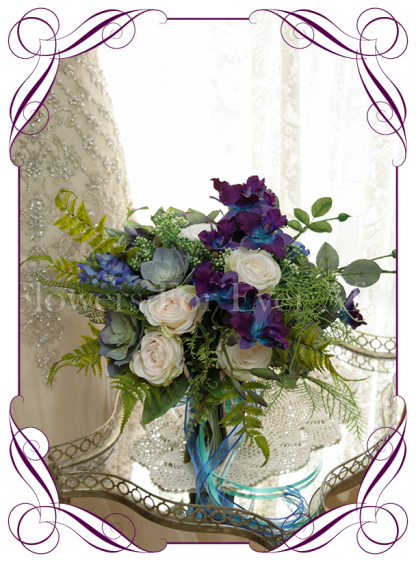Paua shell inspired silk flower bridal bouquet design. With artificial blue galaxy orchids, blue roses, succulents, roses, berries, hydrangea and fern. A natural boho theme / style. Great for a forest / bush, garden or beach wedding