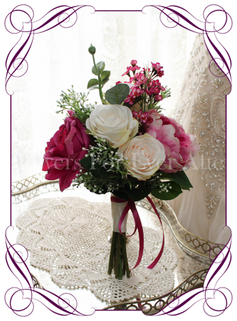 A romantic vibrant magenta pink and blush ivory bridesmaid posy silk artificial wedding bouquet. Perfect for a garden, rustic or boho style wedding.