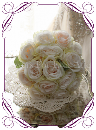 Ivory and blush silk artificial roses in a class romantic bridesmaid bouquet design. An elegant posy in a simple clean style. Made in Melbourne. Custom order. World wide shipping.