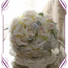 Ivory and blush silk artificial roses in a class romantic bridal bouquet design. An elegant posy in a simple clean style with added bling brooches. Made in Melbourne. Custom order. World wide shipping.