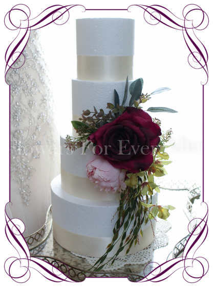 Burgundy artificial silk rose, blush pink peony, Australian native gum leaves and green orchid draping cake decoration, topper. Wedding cake flowers, wedding cake topper.