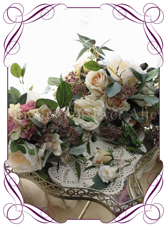 Cascading bridal silk artificial posy bouquet. With champagne and vintage cream roses and peonies, Australian gumnuts and native foliage. Made in Melbourne, shipping worldwide.