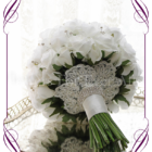 Silk artificial white rose and bling wedding bridal bouquet in an elegant design with bridal lace accents.