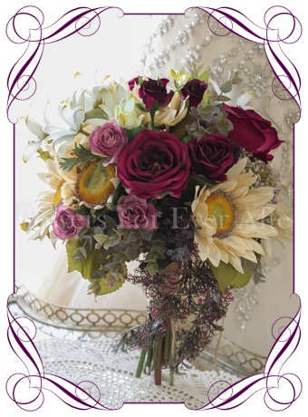 Autumn / fall colour / color tone draping posy bridal silk artificial bouquet. With cream sunflower blooms, plum burgundy roses, and purple cascading fern and native foliage. Made in Melbourne, shipping worldwide.