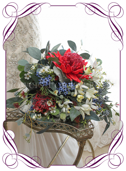An elegant artificial bridal bouquet with silk red warratah, white and blue Australian natives with eucalypt and gum leaves. Loose rustic silk bouquet, boho style. Made in Australia. Buy online, ship worldwide
