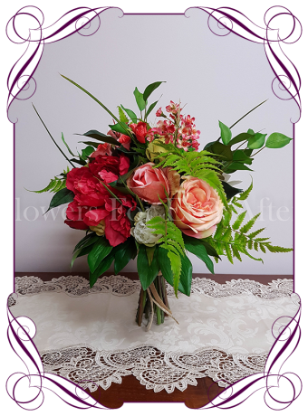 Vibrant tropical silk artificial bouquet in red, coral and yellow. With peonies, frangipani and succulents. Colourful / colorful wedding posy bouquet