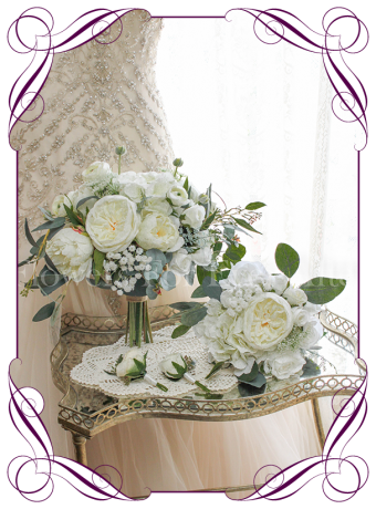 White silk artificial bridal bouquet with peonies, roses, ranunculi, hydrangea, native gum in an loose rustic posy. Made in Melbourne. Shipping worldwide