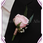 Silk artificial gents boutonniere / wedding button with a classic elegant pink rose with baby's breath and native gum foliage. Made in Melbourne. Shipping worldwide
