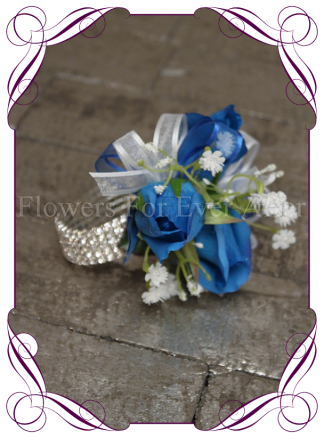 silk artificial real touch royal blue roses and baby's breath / gyp formal / deb / prom / wedding ladies wrist corsage on a stretch diamante bracelet. Shipping world wide. Made in Melbourne Australia.