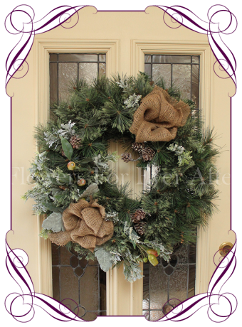 Christmas door wreath with Australian native gum and gumnuts. Burlap and pine cones.