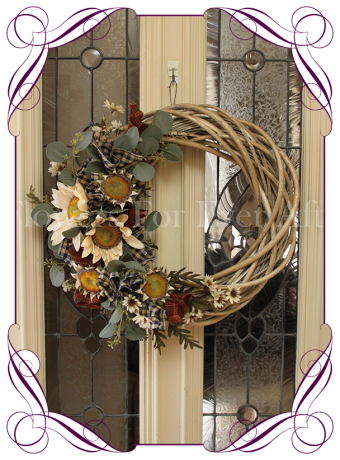 Autumn / Fall door wreath decoration. On a twisted wooden wreath with cream burnt sunflowers, desert daisies, Australian native dollar gum leaves and navy and burnt red fabrics. Made in Melbourne, shipping world wide