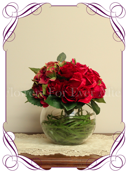 Silk artificial romantic / elegant red and raspberry table centerpiece decoration for wedding, engagement, kitchen tea, office. Red and raspberry fuchsia roses with hydrangea. Can sit in a fishbowl or mason jar. Made in Melbourne. Buy online