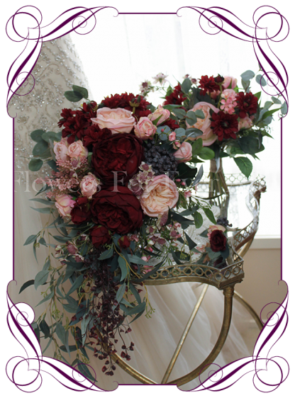 Silk artificial rustic cascading showering bridal tear bouquet with burgundy and apricot pink roses, peonies, gum nuts and native Australian foliage. Package set with bride, bridesmaids and buttons.