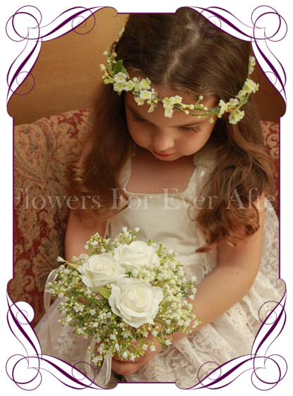 Silk artificial white wedding flower girls posy bouquet with roses and baby's breath.