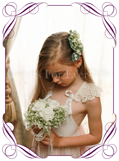 Silk artificial white wedding hair comb with gum foliage and baby's breath.