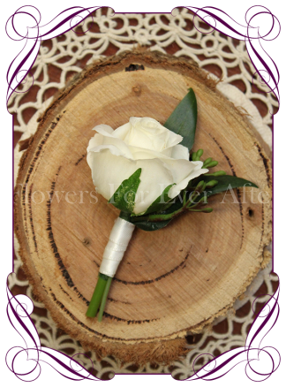 Silk artificial page boy button for weddings and formals, ivory white rose bud. Buy online.