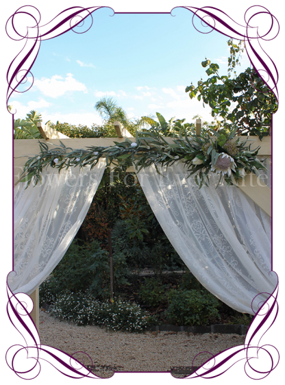 Ivory white silk artificial protea & rustic native gum foliage wedding arbor / arch garland decoration. Made in Melbourne. Buy online