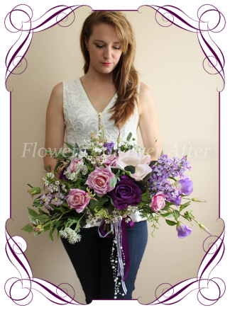 Silk artificial Cadbury purple and lilac large side spray cascading bridal bouquet elegant posy with mixed purple realistic quality flowers. For wedding bridal flower package. Made in Melbourne Australia. Shipping world wide. Best look fashion for 2019 - 2020
