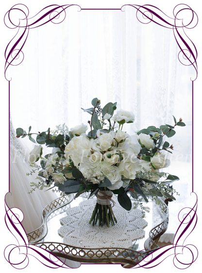 A romantic real look Silk Artificial Bridal Bouquet posy, featuring faux flower white ivory roses, peonies, silver blue gum and textures in a classic bridal style, pink wedding flowers, traditional wedding bouquets. Made in Melbourne by Australia's Best Artificial Bridal Florist. Worldwide Shipping available