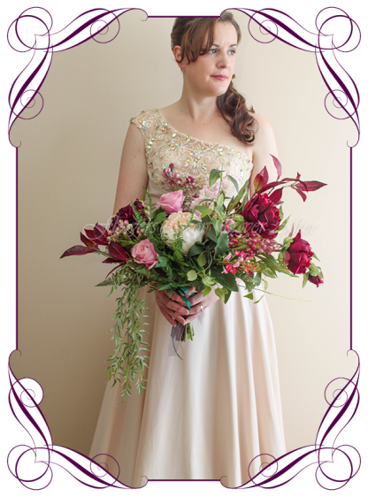 A Realistic Silk Artificial bridal bouquet in a flowing rustic boho bridal bouquet. Featuring faux Peonies, ferns, raspberry, plum colours. Made in Melbourne by Australia's best Artificial Bridal Florist. Shipping worldwide.